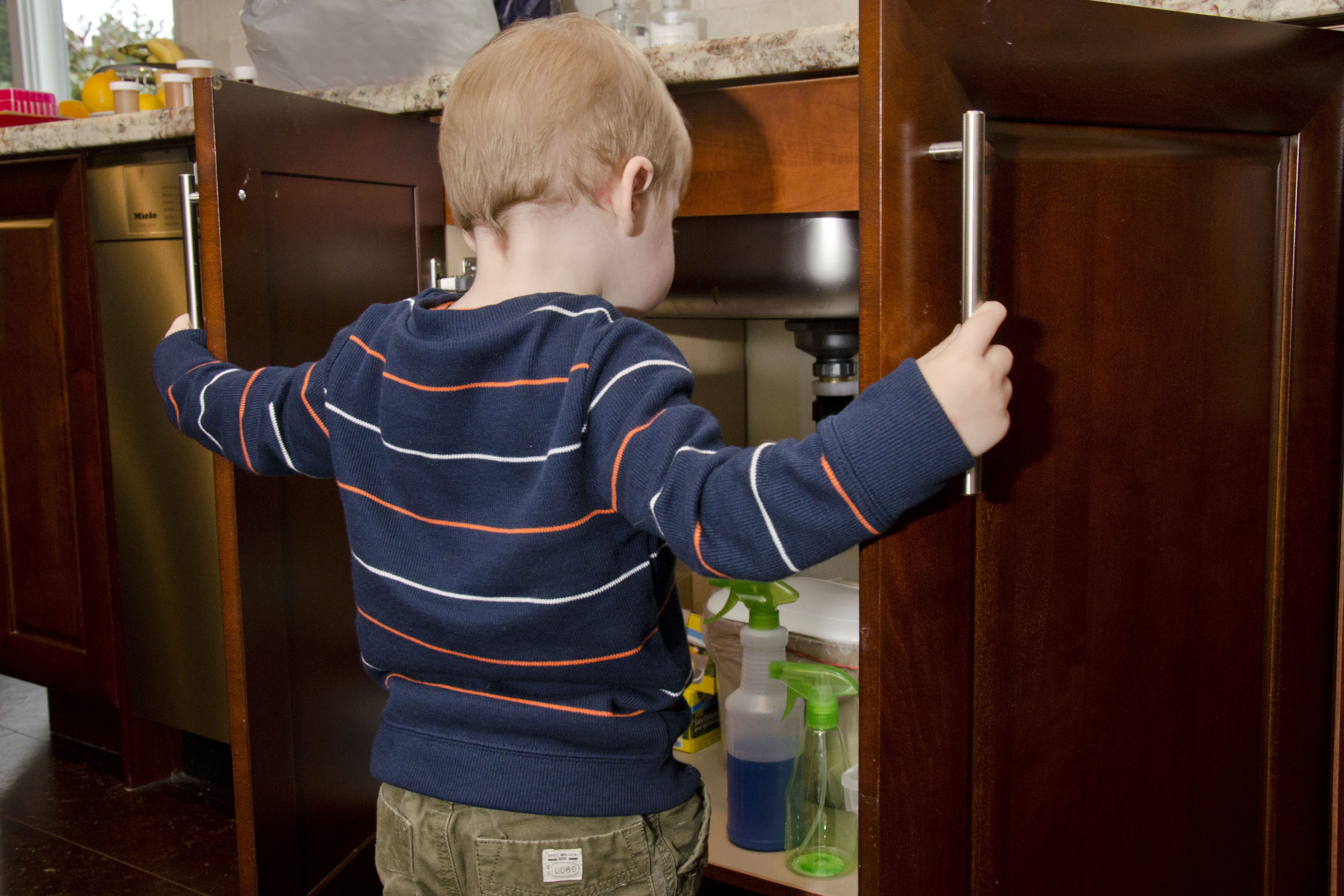 child accessing cabinet
